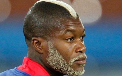 coupe cheveux Djibril Cisse