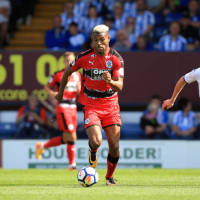 steve-mounie-of-huddersfield-town-in-action-during-the-pre-season-picture-id817138566